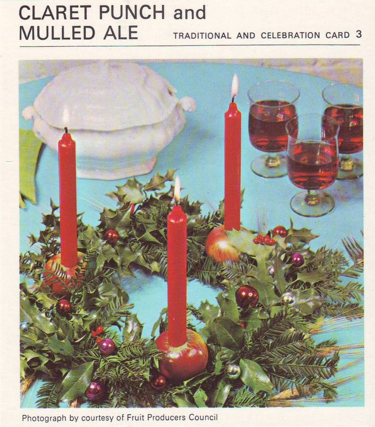 Claret Punch And Mulled Ale, accompanied by a festive wreath with candles stuck in apples, apparently an idea dreamed up by The Fruit Producers Council.