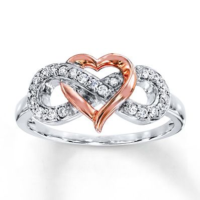 An infinity symbol adorned in round diamonds intertwines with a heart crafted of 10K rose gold in this romantic ring for her. Styled in sterling silver, the ring has a total diamond weight of 1/6 carat. Diamond Total Carat Weight may range from .145 - .17 carats.