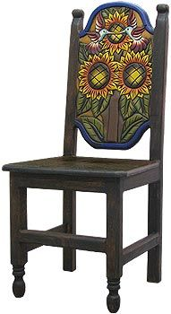This exquisitely hand-carved and hand-painted Sunflower chair was created with pride by the renowned Perla furniture studio of Michoacan, Mexico. Imagine sitting down to a scrumptious south-of-the-border meal with your family and friends in these eye-catching chairs! A striking and colorful addition to your home décor, they're the perfect way to embrace your own Mexican or Southwestern spirit, and to bring out the interior decorator in all of us!