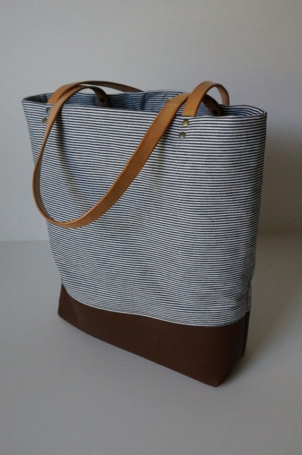 Navy Striped Denim Leather Tote. A handsome leather nautical tote bag and a great gift for her. Railroad Denim, Soft dark brown leather, Vegetable tanned leather straps (will age nicely), Cotton lining (may be different from picture), with a magnetic closure. A great gift for Christmas for her. Handmade in the USA by the Umbrella Collective. http://aftcra.com/umbrellacollective/listing/4619/navy-striped-denim-leather-tote