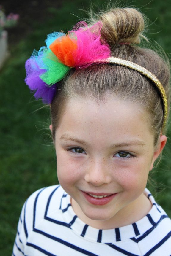 DIY rainbow headband made of rainbow tulle and a gold headband. This headband will be a hit on St. Patrick's Day or any other day of the year!