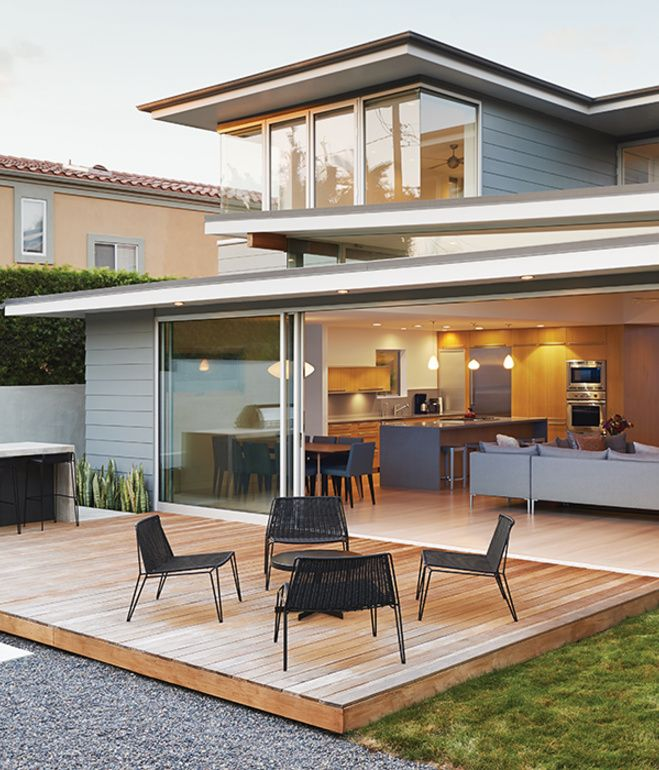 Dwell | A 22-foot sliding-glass door by Fleetwood opens onto an ipe deck furnished with lounge chairs, a cocktail table, and stools from Room &am...