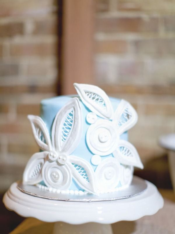 Blue mini cake with white accents