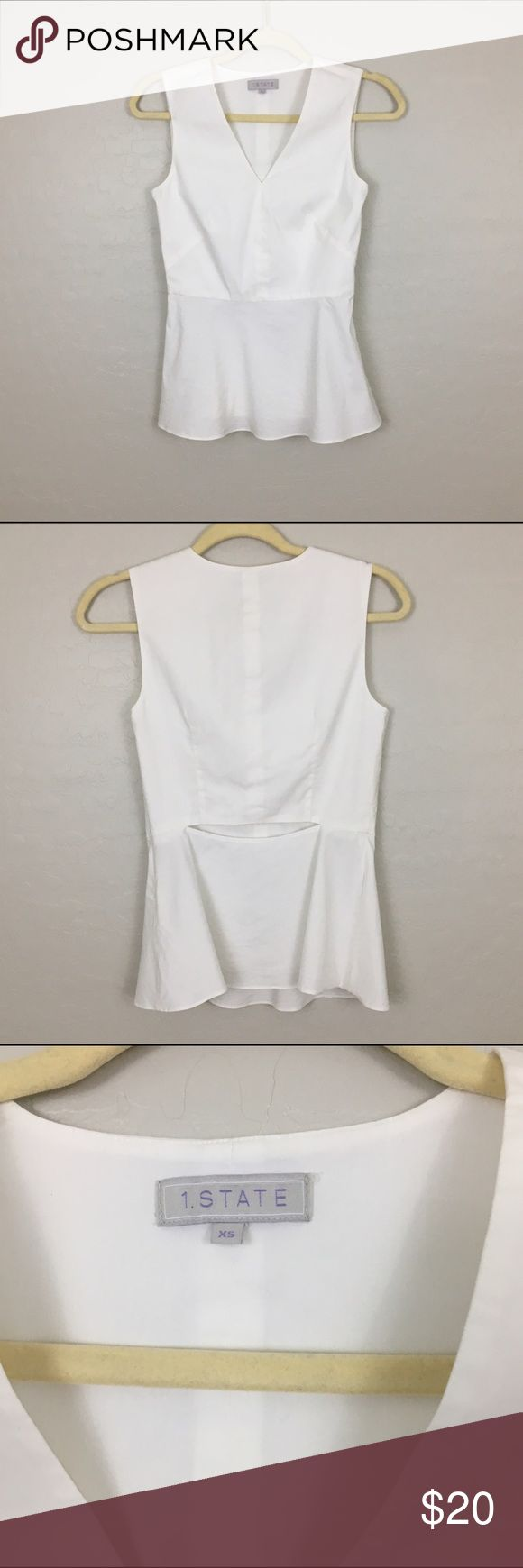 Peplum Top with Cutout Detail Classic white peplum top with great cutout back detail. EUC 1.STATE Tops