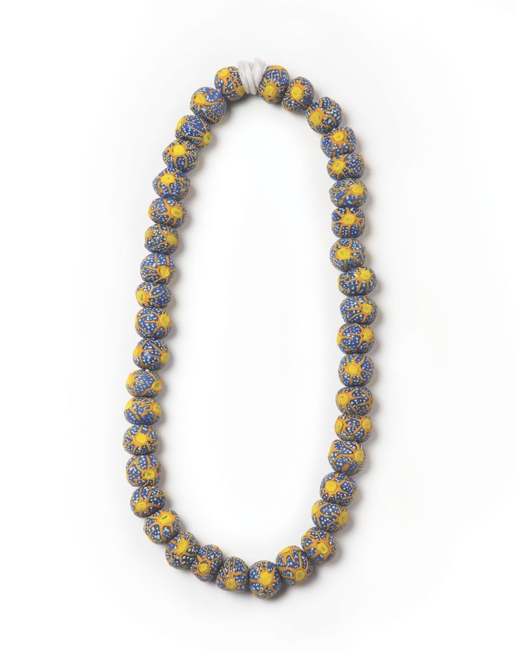 Cedi Beads | Ghana | In Ghana, glass beads are associated with chieftaincy. They are traditional symbols for peace making, wedding ceremonies, and puberty rites. Beads can represent fertility and wealth, and can serve as tokens of congratulations and luck. The beads, with their distinctive, tiny patterns and rich colorations, are wearable works of art.
