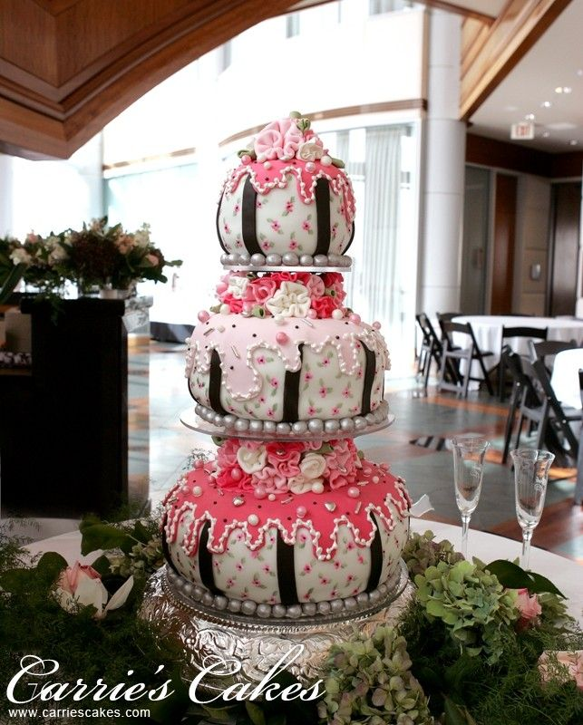 Pink, black, and white whimsical cake.