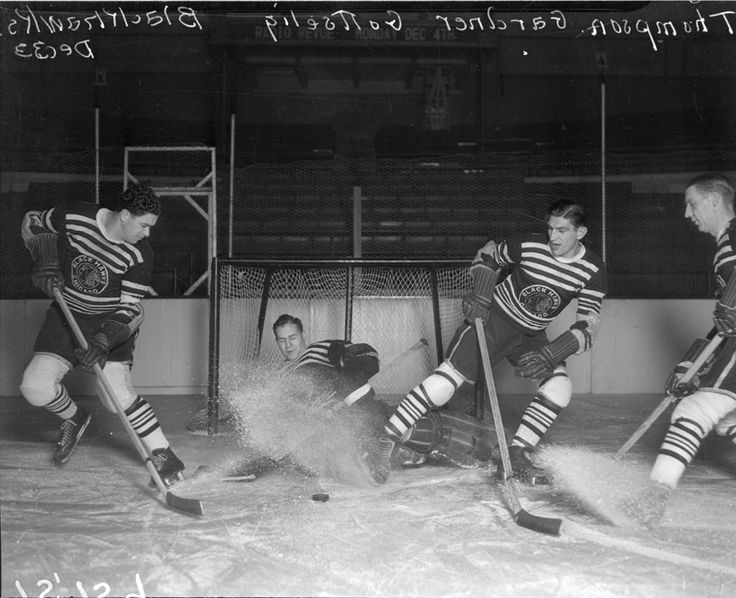 From left: Chicago Blackhawks forward Paul Thompson, goaltender Charlie Gardiner, left winger Johnny Gottselig, and an unidentified teammate scrimmage in December 1933. Photograph by the Chicago Daily News.
