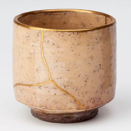 Kintsukuroi. It is the Japanese art of repairing broken pottery with seams of gold. Kintsugi repairs the brokenness in a way that makes the container even more beautiful than it was prior to being broken.  Not a very common idea in western culture!  http://www.kintsugi.jp/gallery.html