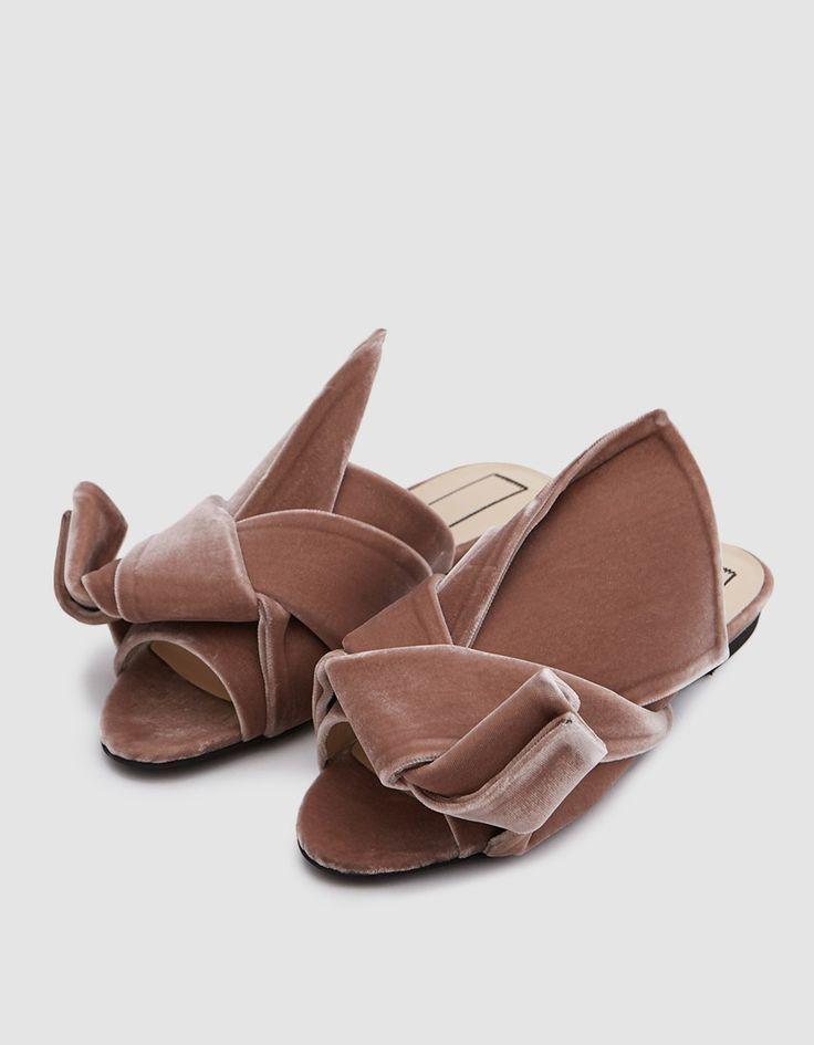 Open toe mule from N°21 in Rose. Slips on. Velvet upper. Bow detail at vamp. Padded footbed. Leather lining.