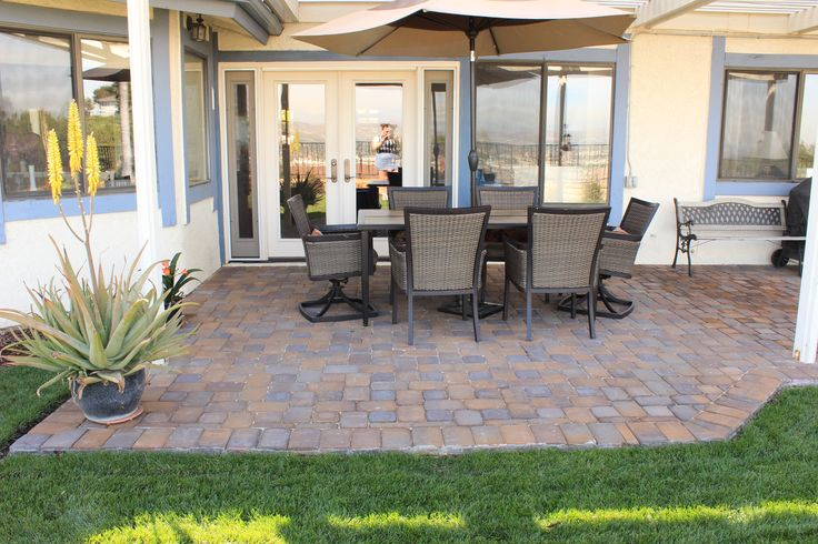Pavescapes Paver overlay installed in the backyard patio area. Paver color shown in this photo is Catalina. #naturalstone #pavers #remodel #construction