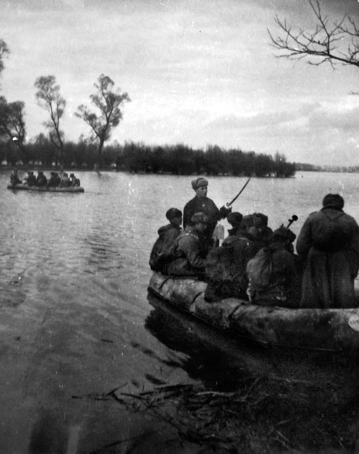 Red Army soldiers crossing the Danube river in inflatable boats.Wwii