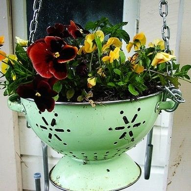 10 Great Mostly Re-purposed Planter Ideas! Here's a sample: Colander Planter Pot.