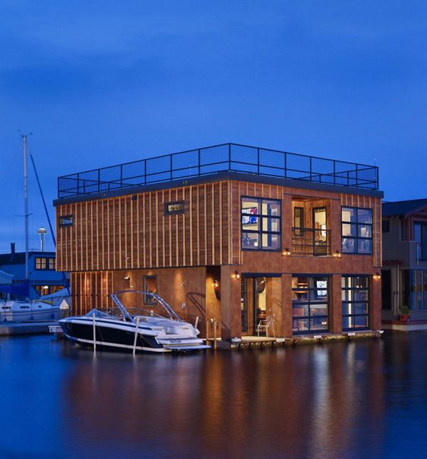 Glass Garage Doors On A Boat House Open Up To Amazing Views