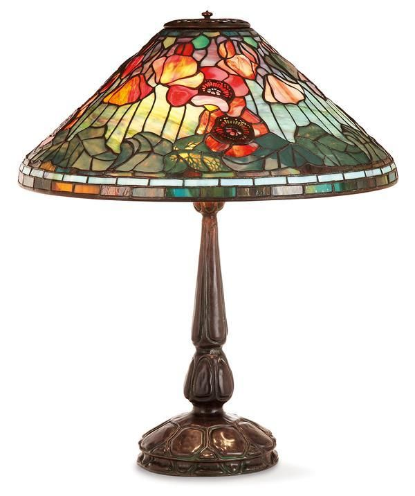 """Louis Comfort TIFFANY (1848-1933) & TIFFANY STUDIOS A """"Red Poppies"""" lamp, polychrome favrile mosaic glass conical lampshade, 1531 model, decorated with a pattern of poppies, skeletal patinated brass, of floral and foliage motifs. A tall stand, model 587, reddish brown patina, stylized foliage decoration and bas-relief decor of petales and scales, three lights with individual bakelight switches. Two signatures."""