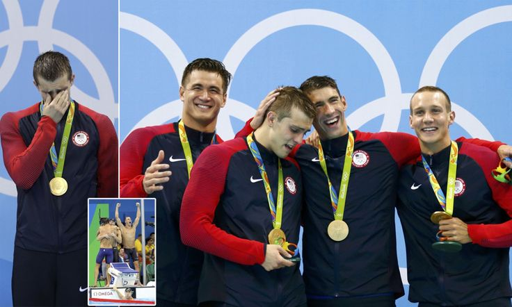 Incredible images show the moment swimmer Ryan Held was overcome with emotion and broke down on the podium after winning a gold medal in the men's 4x100m relay event.