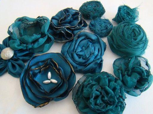 9 different fabric flower tutorials! I love fabric flowers.
