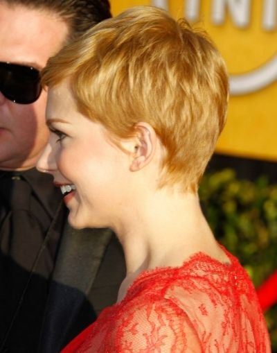 back view of pixie | The My Week With Marilyn star wore a bold lace red dress to the event.