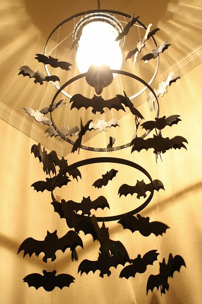 Your light fixture can be easily turned into a spooky bat chandelier with a quick DIY!  Source: A Diamond in the Stuff
