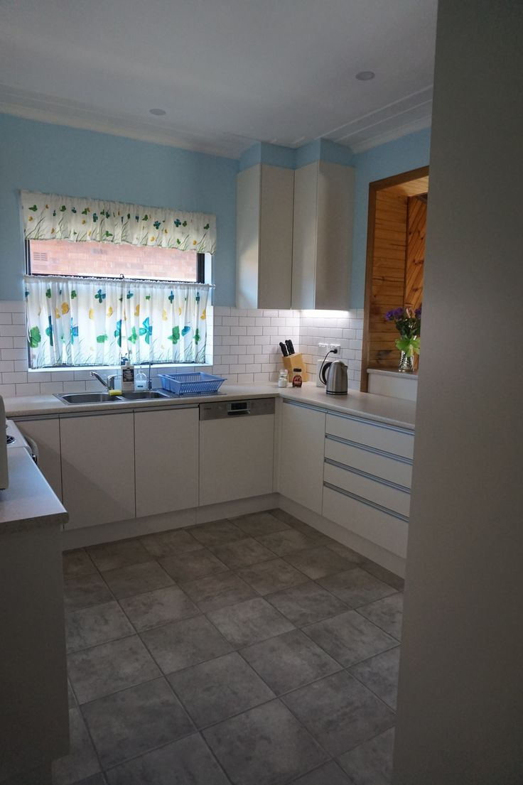 Laminate kitchen cabinetry and bench top Brushed aluminium kickboard Tile splash back Gripless handles
