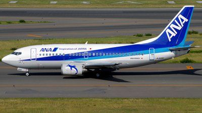 ANA Airways (All Nippon Airways) (JP) Boeing 737-54K JA300K aircraft, with stickers''Dolphins'' on each engine,   rolling at Japan, Nagoya Chubu Centrair Int'l Airport. 07/03/2017.