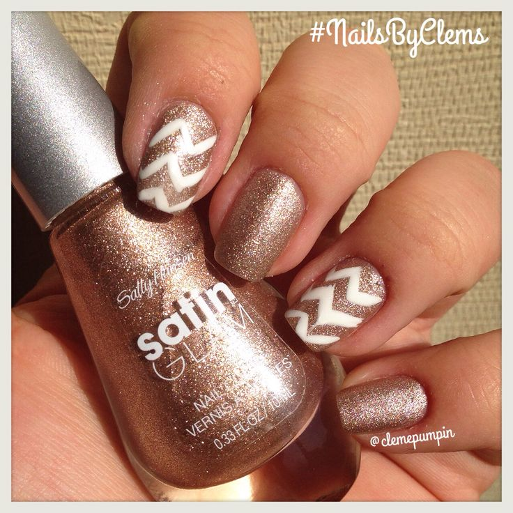 """Hi there! This is my late entry for #nailartsep day 10: #chevron  used @sally_hansen amazing """"Go Gold"""" as base color, do You like it? I think It is gorgeous! It has a sort of #matte finish that makes it look so #glam  Dont forget to give this mani a try with my Nailart Recreation Contest! Check out the rules in the original post, on my feed!  #nails #notd #nailart #swatch #nailporn #nailswag #nailartwow #nailpolish #nailitdaily #nailstagram #NailsByClems"""