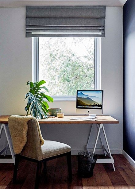 A simple trestle table (Plank And Trestle does similar), a comfy chair and a view of the trees through the large window all meld to create the calming study | Home Beautiful Magazine Australia