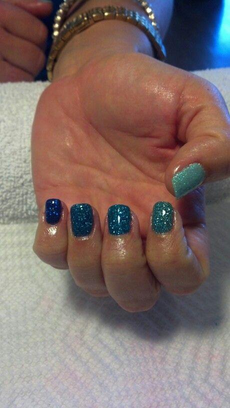 Blue ombre glitter biosculpture gel.