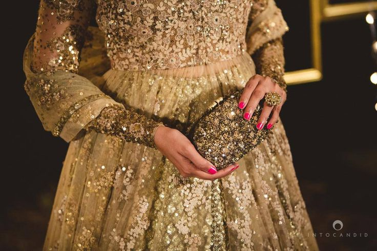 A clutch with embroidery matching that of the lehenga looks ethereal and adds the finishing touches.