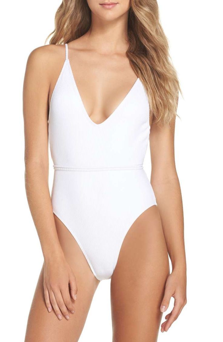 Striped texture flatters this alluring swimsuit cut with a plunging neck, high legs and open back.