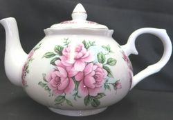 Start a Spring party tradition with this Louisa Rose fine bone china teapot. Holding 36 ounces of delicious, hot tea, the guests will be studying the fine craftsmanship while you are enjoying the delicious aroma. The most intriguing part of this design, is not fine bold lines. There is a distinction between definitions but it lets your mind wonder what the flowers are doing as they wind around the pot. If you look closely, you can even see some light blue in the background to assist in ...