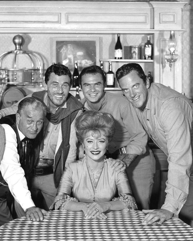 "1964 PUBLICITY PHOTO FOR THE TV SHOW ""GUNSMOKE"". Standing, from left: Milburn Stone (as Doc Adams), Ken Curtis (as Festus Hagen), Burt Reynolds (as Quint Asper) and James Arness (as Marshall Matt Dillon).   eBay!"