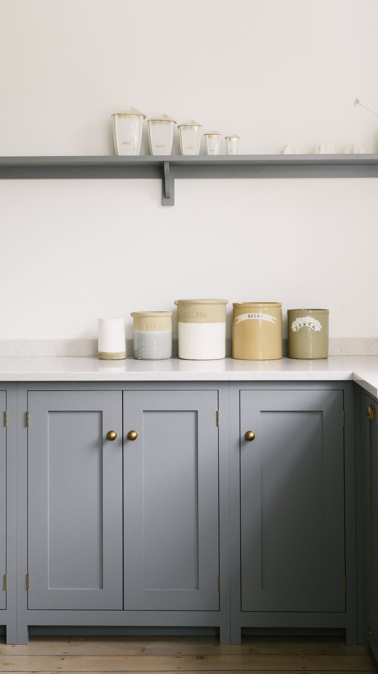 Lovely base cabinets and simple shelving painted in our 'Lead' grey colour and with brass knobs and 'Lagoon' Silestone worktops.