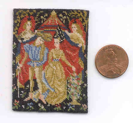 This is a miniature tapesty I made. I put it by a penny to help with scale. there are 42 stitches across per inch.