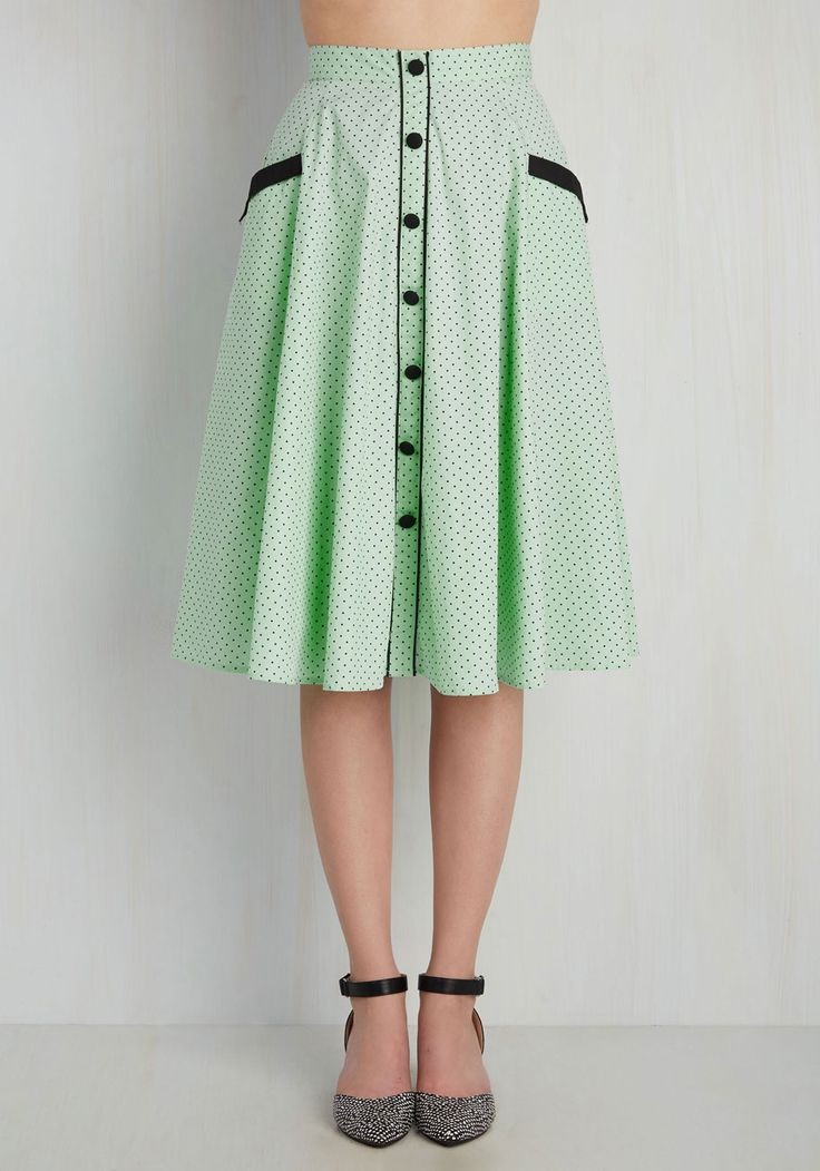 Spark a retro revival in this mint green skirt! You believe that iconic style shouldn't be left in the past, so when you flaunt the airy cotton fabric, functional front pockets, and adorable decorative buttons of this black-dotted midi, all of your vintage-inspired visions permeate the present tense!