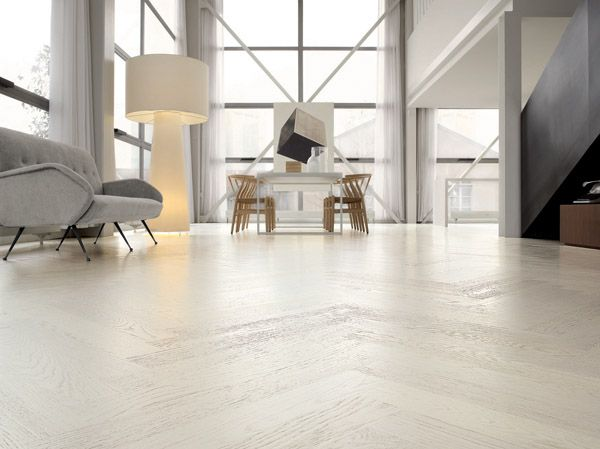 White Lacquered Oak FlooringAn ultra modern style white lacquered oak flooring from Italian designers Listone Giordano. This floor can be supplied as planks, or as a stunning herring bone design as featured in the pictures below. Each plank has been brushed to highlight the wood-grain definition and then painted with a crisp, hard wearing, matt white lacquer