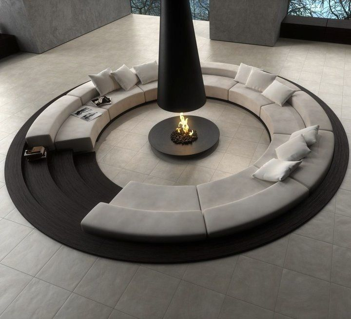 Great lower level social seating area around fireplace. Think about not obstructing eye contact throughout circle.