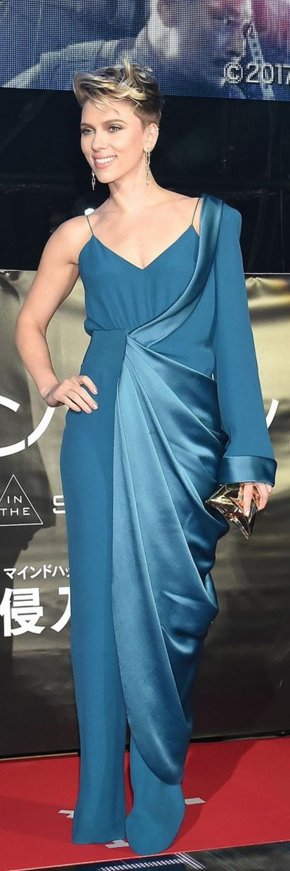 Who made  Scarlett Johansson's blue jumpsuit and gold clutch handbag?