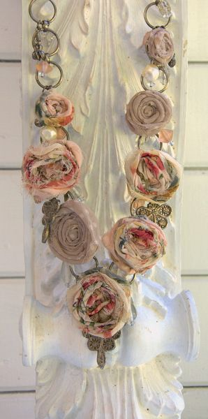 Upcycled dress and belt - roses made with strips of torn dress rolled into spiral and stitched to secure.