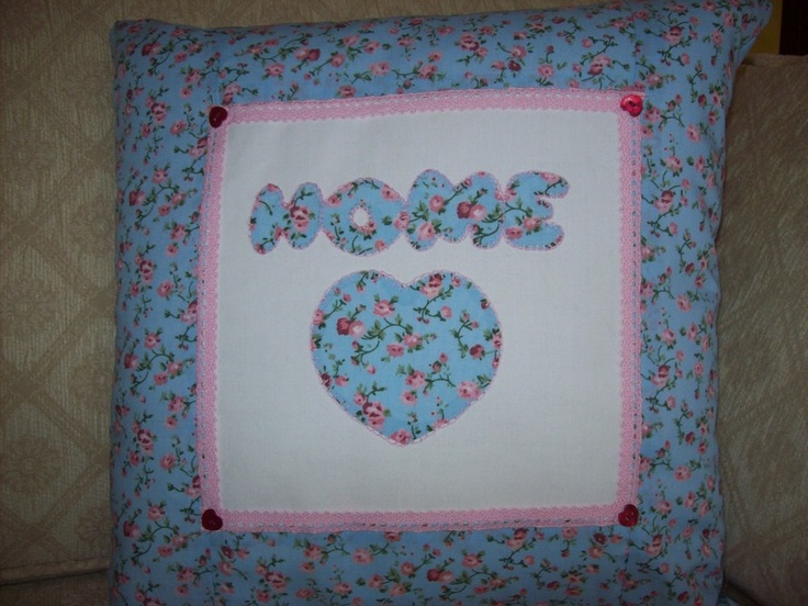 Hand appliqued pretty floral cushion. With pink crochet lase edging and little red heart buttons.  Please take a look at the items I sell @ www.lemayed-for-you.webs.com, thanks.