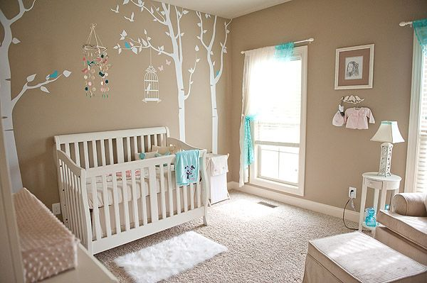 white and tan baby nursery.  accents are blue/aqua but any color accent would look great in this room.  love the tree decal with birdcage