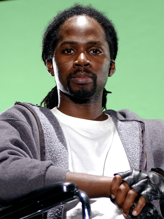 """Harold Perrineau as Augustus Hill in Oz.... """"A man stands in a cemetery, reading a letter he wrote forgiving his long dead father. The mother of a girl killed by a drunk driver is racked with fantasies of retaliation. Your boyfriend begs you for one more chance. You say to your mirror you're done hating yourself. But you know you're not. Maybe instead of forgive and forget, it should be forgive and remember. Remember that you might have to wake up tomorrow and forgive all over again. And…"""