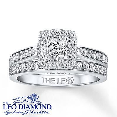 Cut for a princess, the center Leo diamond dazzles amidst more round Leo diamonds.