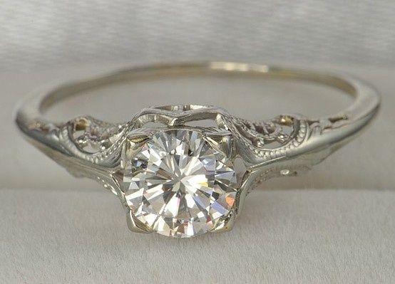 Love the wedding band. Very vintage looking.: