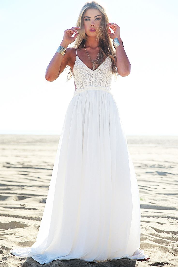 http://www.hauteandrebellious.com/collections/dresses/products/camilla-open-back-crochet-maxi-dress-white