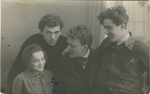The staff of the Belorussian GOSET: left to right: actress Elizaveta (Leya) Nelson, conductor and composer Boris Ponizovskiy, A. Osmerkin, actor and director B. (Ben) Nord. Minsk, Photo-Union, late 1920s. - Jewish Museum and Tolerance Center, Moscow, Russia — Google Arts & Culture