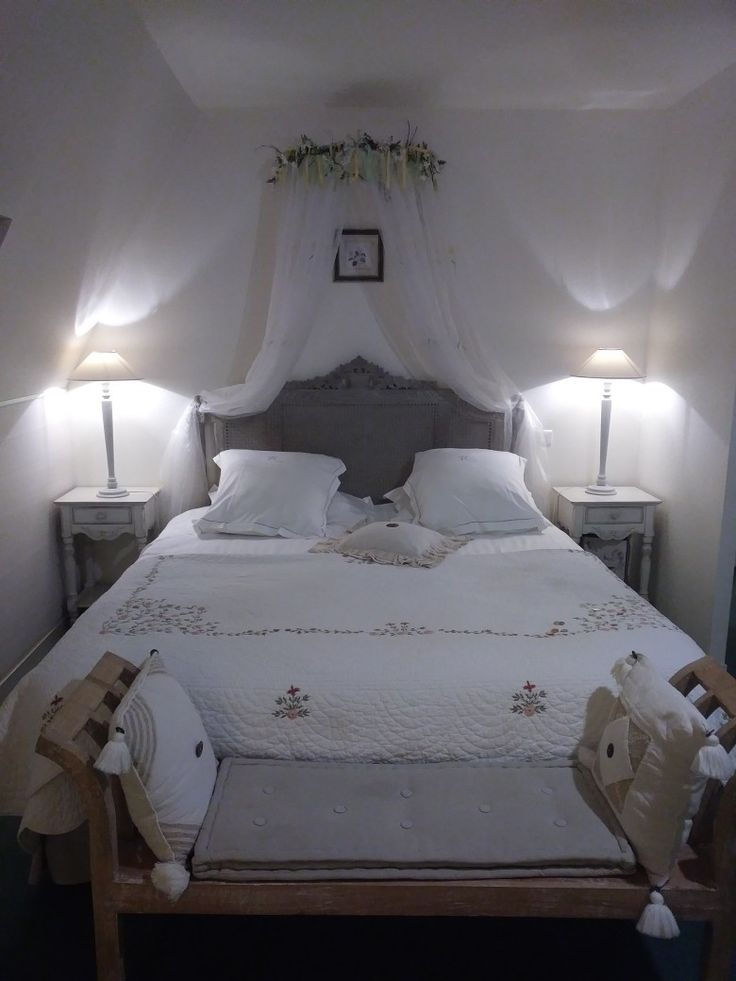 Romantic bedroom at Hotel Ramade Avranches, France.