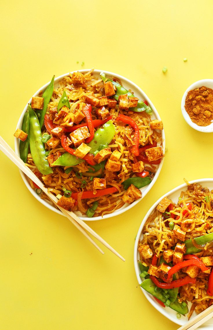Vegan Singapore Noodles!  My substitutes: -- Tempeh instead of Tofu -- Zucchini & Yellow Squash Zoodles instead of Pasta -- Green Bell Pepper instead of Red -- DIY Curry Powder (from Minimalist Baker site)