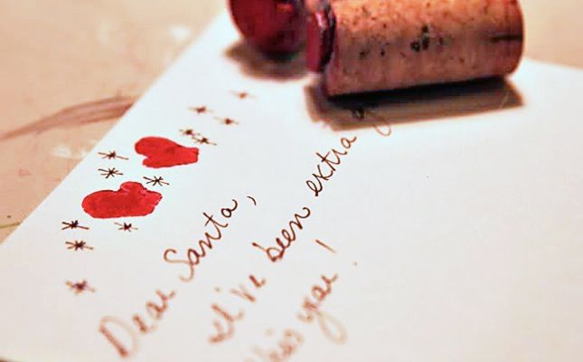 DIY these mitten wine cork stamps to add a festive touch to any greeting card.