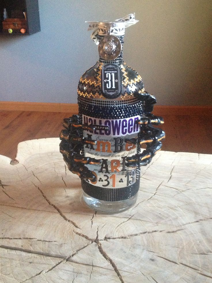 Diy decorated liquor bottle. Got the jewels from micheals. :)
