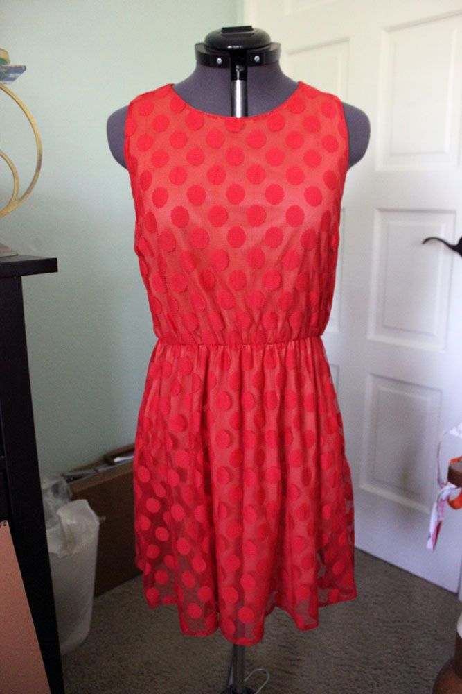 Ruche dress, size small. The lining is a peach color and the over layer is a red sheer polka dot fabric. Has a button on the top of the back. Elastic waist. Sell for $20 shipped